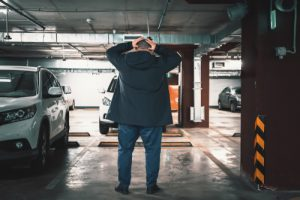 man at empty parking space has been a victim of car theft